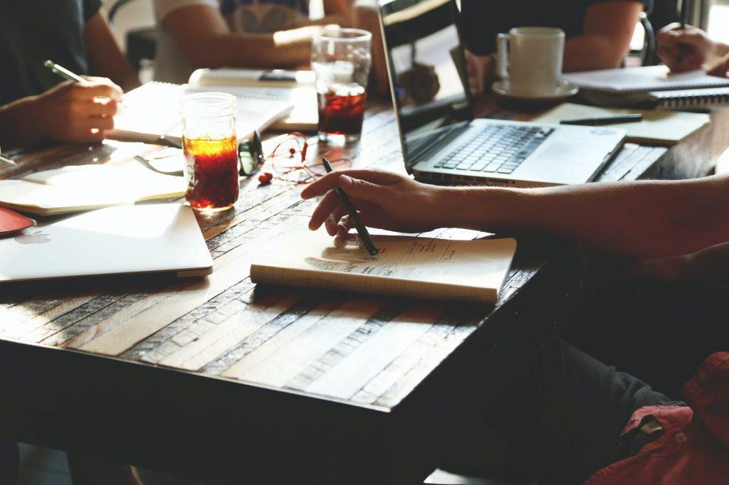 people notes meeting team